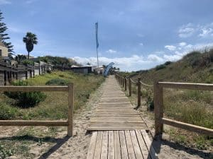 Wooden boardwalk alongside El Arenal sand dunes on el rosario beach.